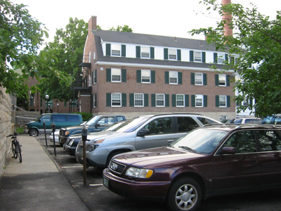 Brewster Hall and parking lot, site of Maffei Arts Plaza